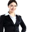 Portrait confident young business lady standing against white background Royalty Free Stock Photos