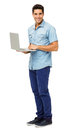 Portrait of confident young man holding laptop full length against white background vertical shot Royalty Free Stock Photography