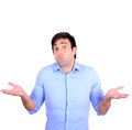 Portrait of confused clueless young man against white background this image is made in studio with model standing set various Stock Images