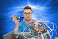 Portrait of confused it professional with screw driver and cables in front of ope composite image young open cpu Stock Photo