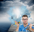 Portrait of confused it professional with screw driver and cables in front of ope composite image young open cpu Royalty Free Stock Photos