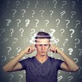Portrait confused thinking young man with vertigo dizziness has many questions. Human face expression