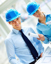 Portrait of contracters in blue helmet Royalty Free Stock Image
