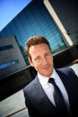 Portrait of corporate businessman standing on front of office building Royalty Free Stock Photo