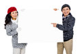 Portrait of couple with blank cardboard against white background Stock Photo