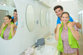 Portrait couple in communal washroom Royalty Free Stock Photo