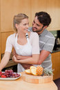 Portrait of a couple eating fruits Royalty Free Stock Images