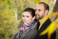 Portrait of couple enjoying golden autumn fall season Stock Images