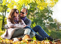 Portrait of couple enjoying golden autumn fall season Stock Photos