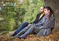 Portrait of couple enjoying golden autumn fall season Stock Image