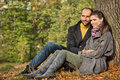 Portrait of couple enjoying golden autumn fall season Royalty Free Stock Image