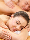 Portrait of a couple getting a romantic massage Stock Photos