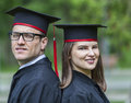 Portrait of a couple in the graduation day outdoor young students park Stock Images