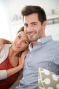 Portrait of couple at home sweet relaxing in sofa Royalty Free Stock Photos