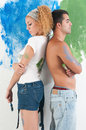 Portrait of couple painting at home awhite wall Stock Photo
