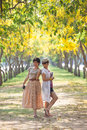 Portrait of couples beautiful asian woman standing women in blooming flowers park with happieness emotion Royalty Free Stock Photos