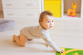 Portrait of crawling funny baby boy indoors at home Royalty Free Stock Photo