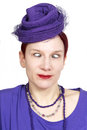 Portrait of cross eyed woman with purple vintage hat red haired Royalty Free Stock Photo