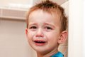 Portrait of crying baby boy in home Royalty Free Stock Image