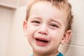 Portrait of crying baby boy in home Stock Photo