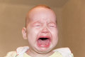 Portrait of a crying baby. Tears on the face Royalty Free Stock Photo