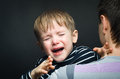 Portrait of a crying child on hands father Stock Images