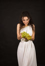 Portrait of a curly girl holding a bunch of grapes Royalty Free Stock Photo