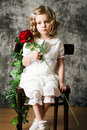 Portrait of curly girl with rose red retro style Royalty Free Stock Image