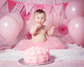 Portrait of cute adorable Caucasian baby girl with blue eyes in pink tutu skirt celebrating her first birthday Royalty Free Stock Photo