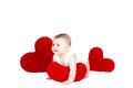Portrait of a cute adorable little valentine angel with red soft heart isolated on white background infant girl hugging large toy Royalty Free Stock Photos