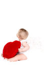Portrait of a cute adorable little valentine angel with red soft heart isolated on white background infant girl hugging large toy Stock Images