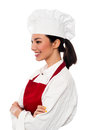 Portrait of cute asian female chef side posing with arms folded Stock Photo