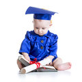 Portrait of cute baby in academic hat with book boy and scroll Stock Images