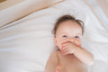 Portrait of cute baby boy high angle in bed Royalty Free Stock Photography