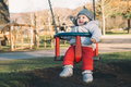 Portrait of cute baby on swing, outdoors. Royalty Free Stock Photo