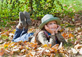 Portrait of cute blue eyed girl with hat relaxing in autumn park colored Royalty Free Stock Images