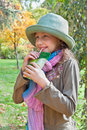 Portrait of cute blue eyed girl in park with hat relaxing autumn colored Stock Photography