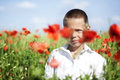 Portrait of cute boy in poppy field Royalty Free Stock Images