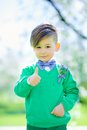 Portrait of cute boy showing thumbs up close handicapped outside Royalty Free Stock Photos