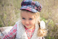 Portrait of a cute cheerful little girl on a nature. Royalty Free Stock Photo