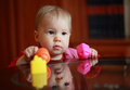 Portrait of cute child with toys Royalty Free Stock Photo