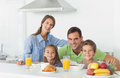 Portrait of cute family having breakfast at home in kitchen Stock Image