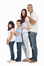 Portrait of a cute family in single file on white background Royalty Free Stock Image