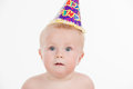Portrait of cute funny baby in birthday party hat looking at camera isolated over white background Stock Photography