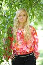 Cute girl in the foliage of a birch Royalty Free Stock Photo