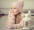 Portrait of cute girl in hat and gloves at Christmas time Royalty Free Stock Photo