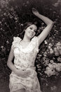 Portrait of cute girl lying on meadow with flowers black and white Royalty Free Stock Image