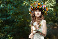 Portrait cute girl with wreath of flowers a a she s in the woods Stock Photography