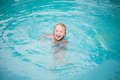 Portrait of cute happy little girl having fun in swimming pool, Royalty Free Stock Photo