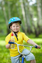 Portrait of a cute kid on bicycle Royalty Free Stock Photos